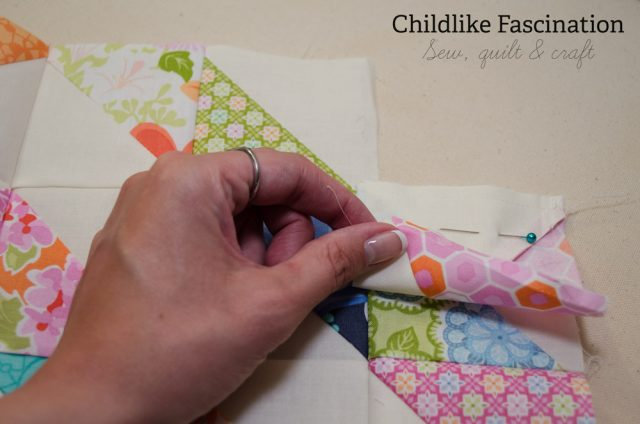 Sew the block to the side where the seam is cut extra