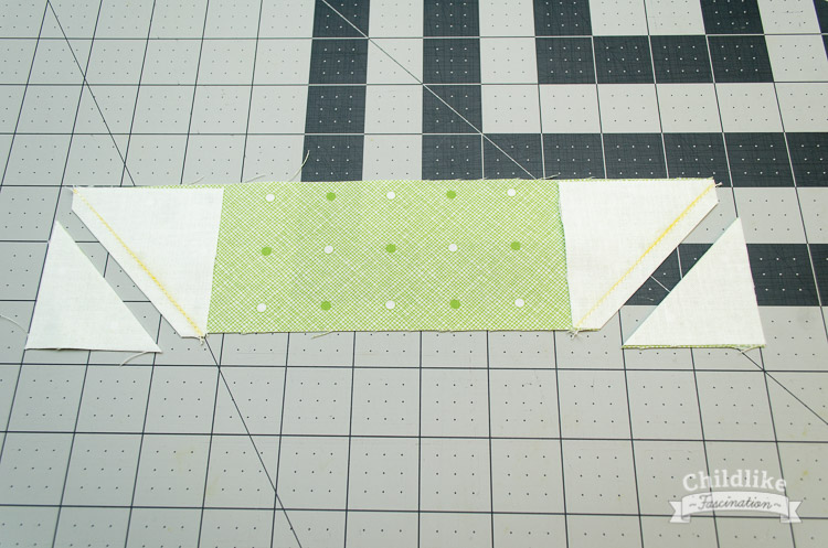 """Sew along the marked line and trim corners off 1/4"""" away from seam"""